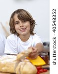 Smiling Child Eating Bread In...