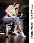 portrait of sporty female doing ... | Shutterstock . vector #405595963