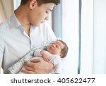 little newborn is sleeping on...   Shutterstock . vector #405622477