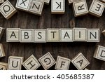 Small photo of the word of ABSTAIN on building blocks concept