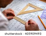 man architect draws a plan ... | Shutterstock . vector #405909493