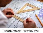 man architect draws a plan ... | Shutterstock . vector #405909493