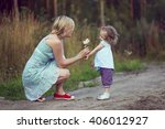 a little girl gives flowers for ... | Shutterstock . vector #406012927