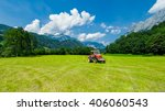 harvesting crop by red tractor... | Shutterstock . vector #406060543