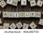 Small photo of the word of ADJOURN on building blocks concept