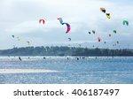 kitesurfers enjoying wind power ... | Shutterstock . vector #406187497