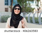 smiling girl in hijab covering... | Shutterstock . vector #406263583