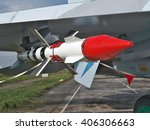 Small photo of Long range air-to-air missile mounted under the wing of a fighter