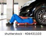 mechanic in blue uniform lying... | Shutterstock . vector #406431103