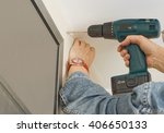 handyman drilling a hole for a... | Shutterstock . vector #406650133