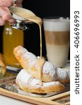 croissant in powdered sugar  | Shutterstock . vector #406696993