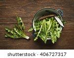 fresh dandelion on wooden... | Shutterstock . vector #406727317