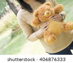 woman holding teddy bear | Shutterstock . vector #406876333