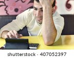 guy in cafe with tablet | Shutterstock . vector #407052397