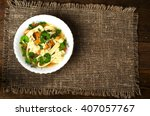 soup in plate on wooden table . ...