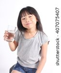 young little girl drinking... | Shutterstock . vector #407075407