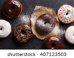 Colorful Donuts On Stone Table...