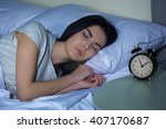 Young Woman Sleeping In Bed...
