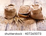 Wheat Grains In Sacks On Woode...