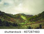 mountain view and farmland in... | Shutterstock . vector #407287483