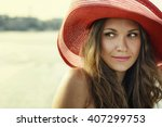 beautiful girl in a red hat... | Shutterstock . vector #407299753