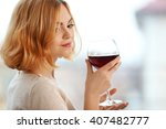 young woman with glass of red... | Shutterstock . vector #407482777