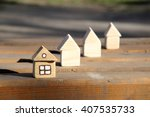 wooden houses in various stages ... | Shutterstock . vector #407535733