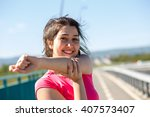 young sportswoman stretching... | Shutterstock . vector #407573407