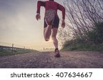man trail running in the country | Shutterstock . vector #407634667