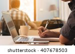man taking note with laptop in...   Shutterstock . vector #407678503