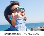 young man talking on telephone... | Shutterstock . vector #407678647