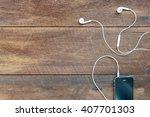 white earphones and mobile... | Shutterstock . vector #407701303