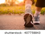 close up woman shoes running in ... | Shutterstock . vector #407758843