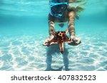 woman is snorkeling underwater  ... | Shutterstock . vector #407832523