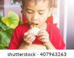 Little Caucasian Boy Eating...