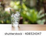 glass of water and ice on soft... | Shutterstock . vector #408524347
