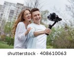 happy young family taking... | Shutterstock . vector #408610063
