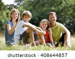a family sitting together on... | Shutterstock . vector #408644857