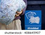 a man recycling a bag of... | Shutterstock . vector #408645907