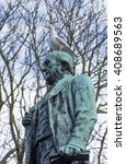 Small photo of The 1904 Gladstone Memorial, St John's Gardens, Liverpool. Sir Thomas Broc. Verdigris coloured bronze with a seagull.