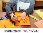 child trace around a hand on... | Shutterstock . vector #408747937