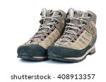 old scuffed hiking boots on... | Shutterstock . vector #408913357