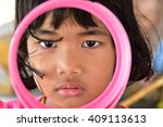 little girl is looking with... | Shutterstock . vector #409113613
