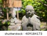 Stone Buddha In The Garden Of...