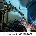 welding robots represent the... | Shutterstock . vector #409204477