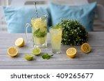 lemon lemonade on the table in... | Shutterstock . vector #409265677