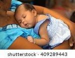 asian newborn baby peacefully... | Shutterstock . vector #409289443