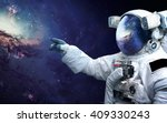 astronaut in outer space.... | Shutterstock . vector #409330243