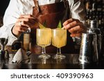 barman is decorating cocktail... | Shutterstock . vector #409390963