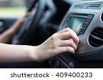 woman turning button of radio...   Shutterstock . vector #409400233